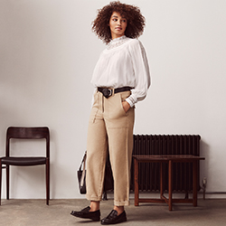 Woman wearing white blouse and cargo pants