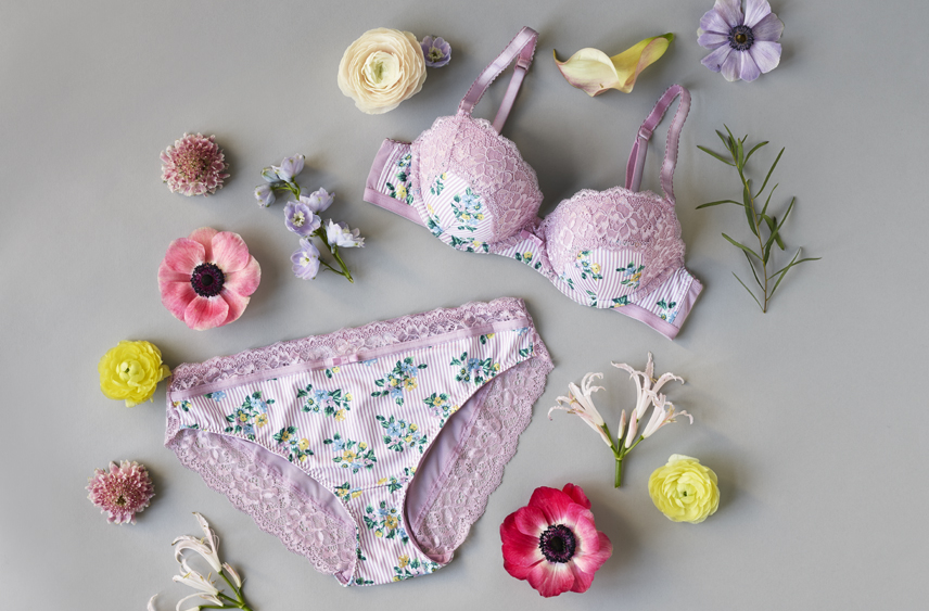 Lilac floral bra and brief set, surrounded by flowers